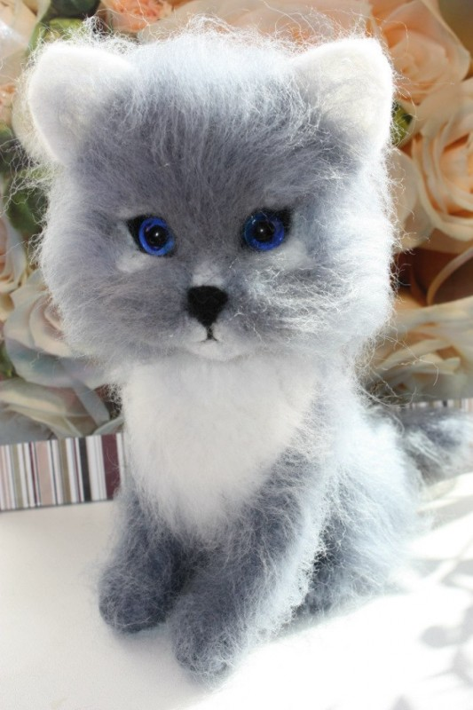 Котенок Пушистик.