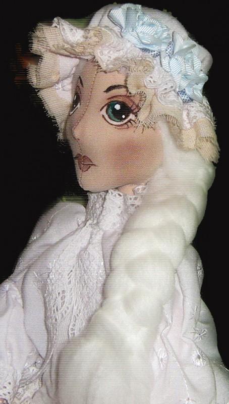 Текстильная кукла в винтажном стиле.